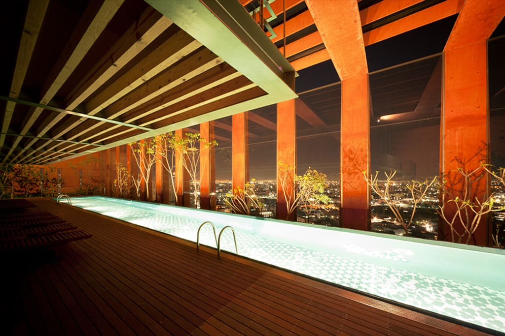 our infinity pool at night