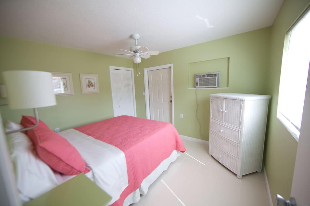 """""""Sandy Toes"""" bedroom has a queen bed, TV in cabinet"""