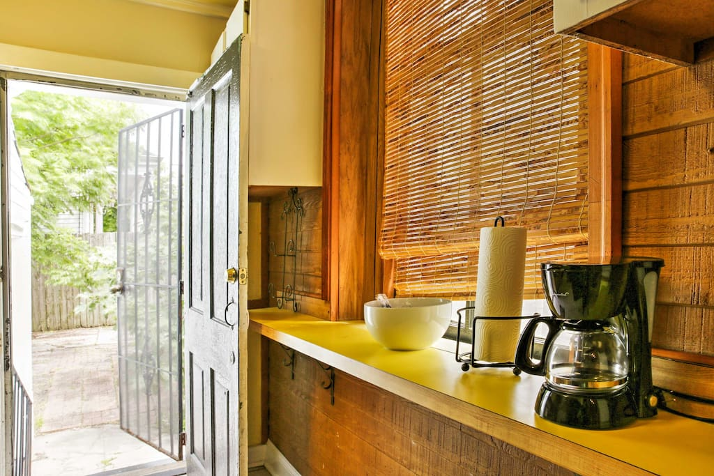 The back of this shotgun house leads into the fully-equipped kitchenette.