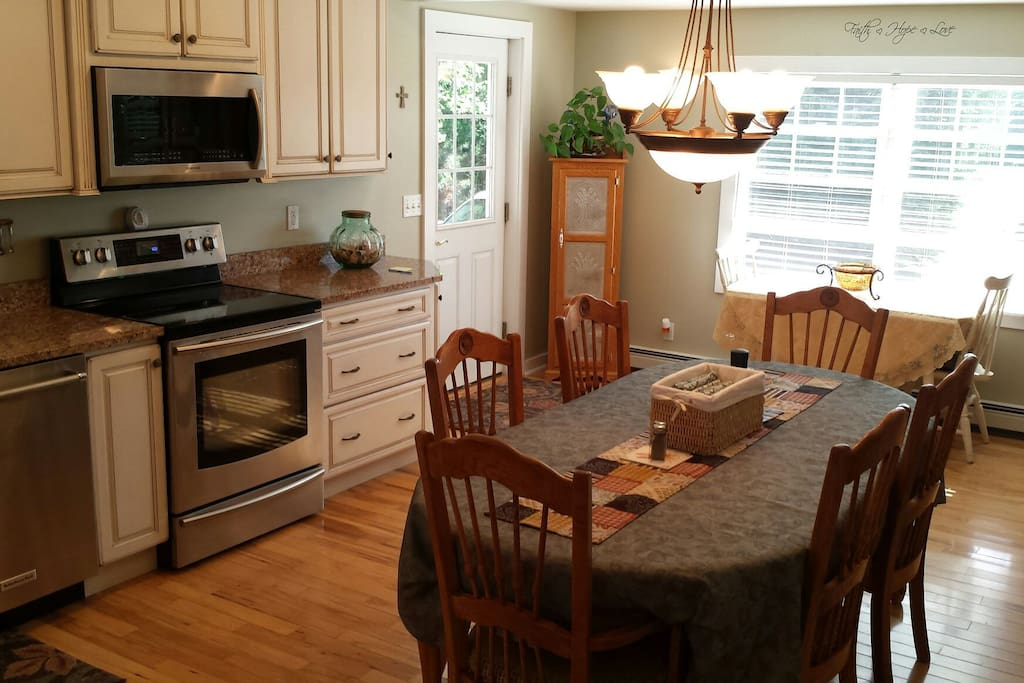 Spacious country kitchen with new appliances and granite counter tops