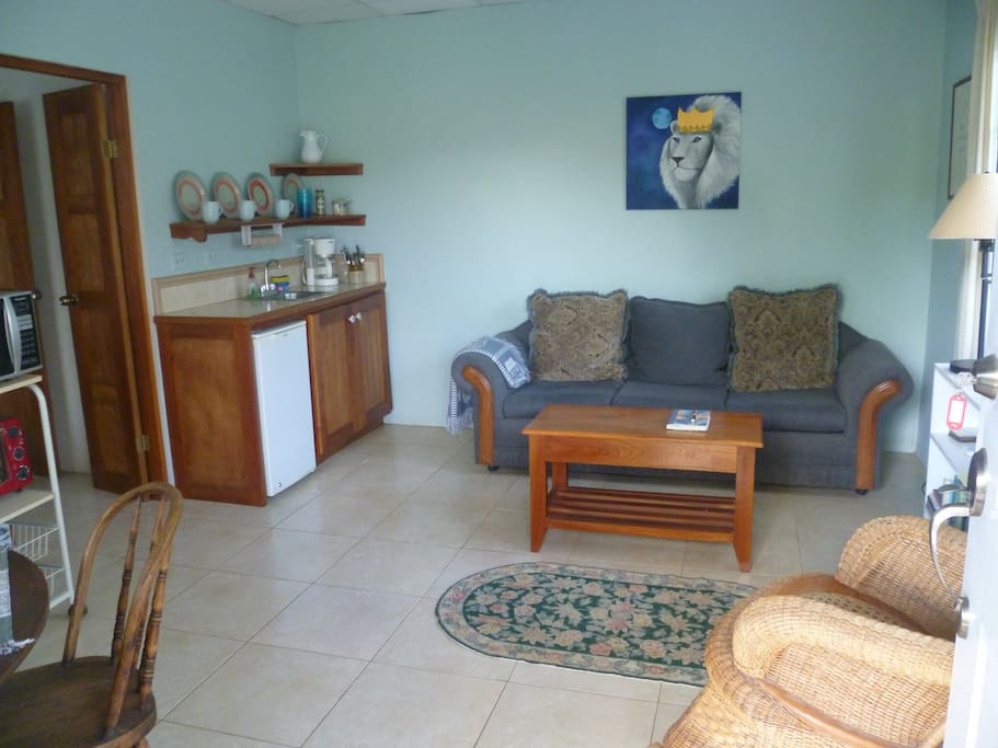Living room with an almost 6 foot sofa, for an extra person.
