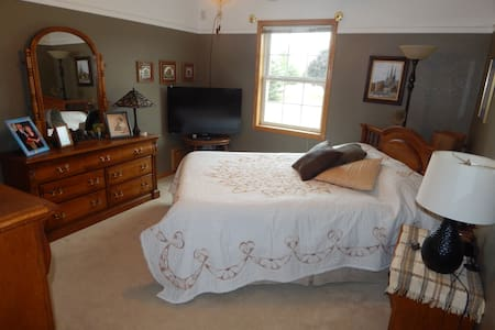 Comfortable queen bedroom suite with pool views - Muskego