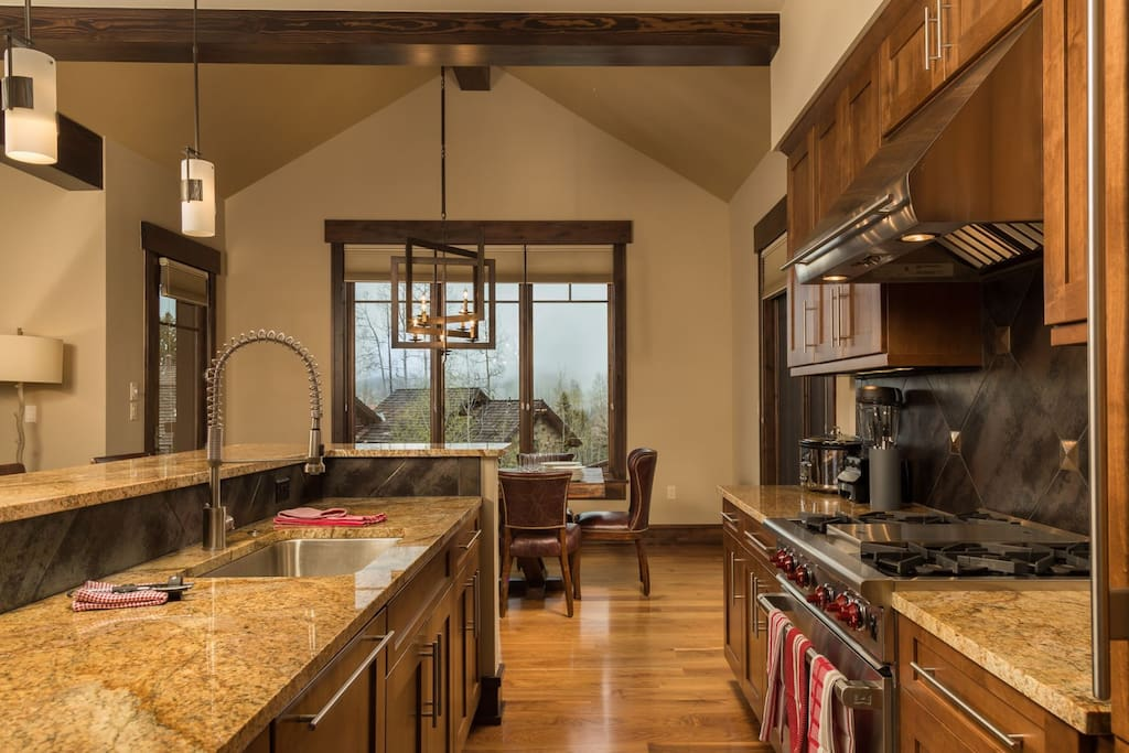 Great open kitchen with range, oven, dishwasher, and all stainless appliances