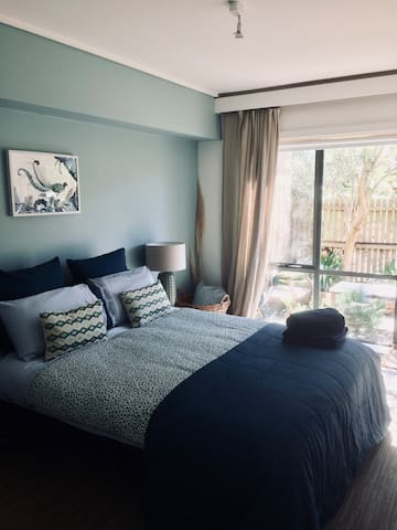 Bedroom with 100% cotton 1200 thread count sheets, opens to courtyard.