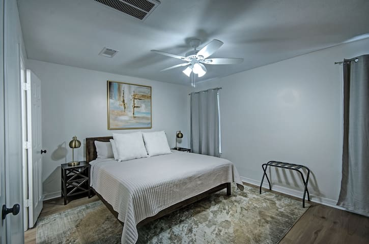 A king bed upstairs with two closets.