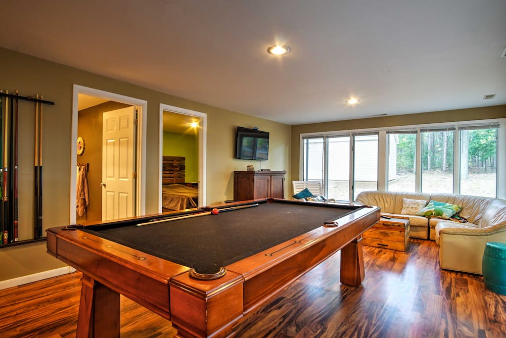 Compete in a game of pool with friends inside the home.