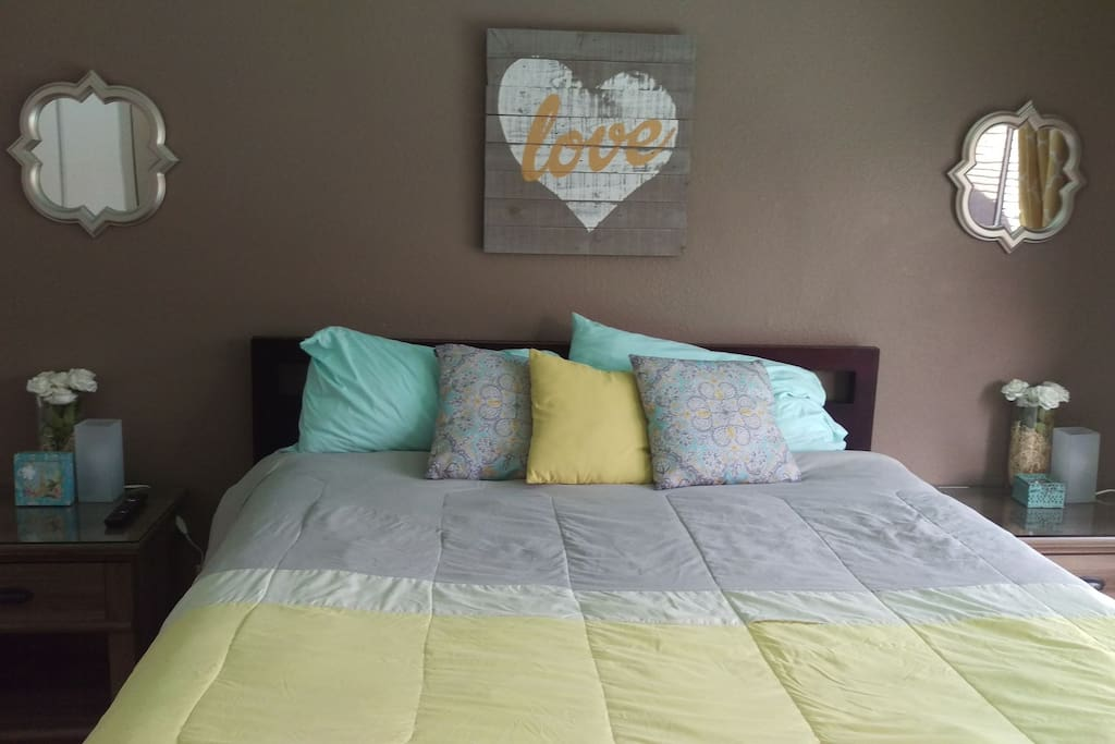 Gorgeous master bedroom with large California King bed