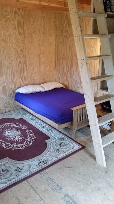 Full  sofa / bed first floor.  Steep ladder to loft with full futon mattress.