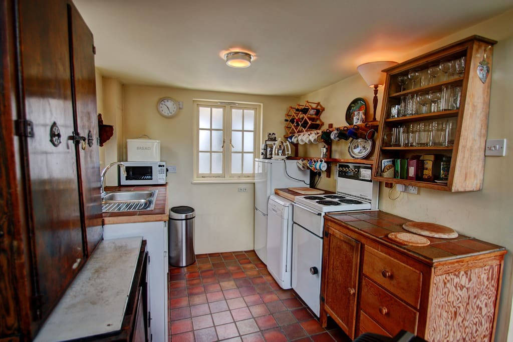 The kitchen is small but well-equipped, with a dishwasher, fridge, microwave etc.