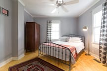 Spacious front bedroom with luxe Queen-sized Casper mattress and soft white linens.