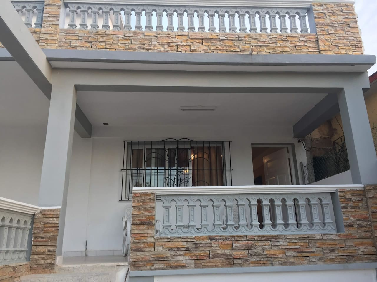 Entrance to the Studio/Apartment and porch for Guests. Notice the private entrance to the Apartment.
