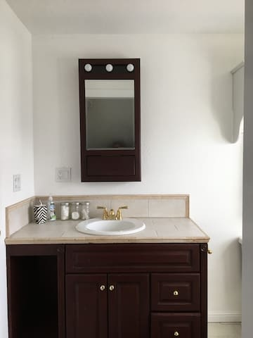 Private bath includes shower (not shown)  and cherry wood vanity