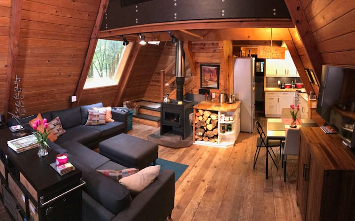 Rustic 70's A-frame with a cozy modern interior