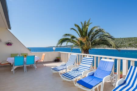 Apartment with big sunny terrace and private beach