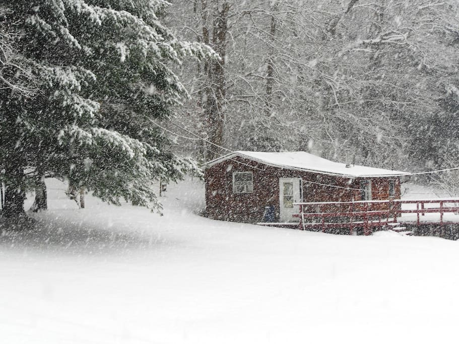 The cabin in winter. Gas heat keeps it cozy and comfy for when you come in from hiking, cross-country skiing or a good snowball fight.