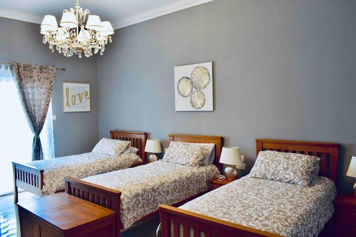 Bedroom #1  Ground floor, 3 single beds.