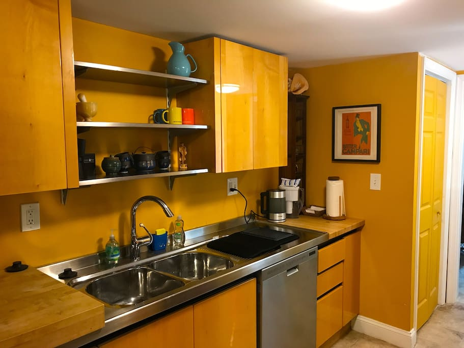 Well stocked kitchen with dishwasher, nespresso machine, microwave and viking stove.