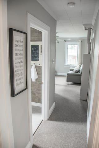 Hallway to bathroom and living room