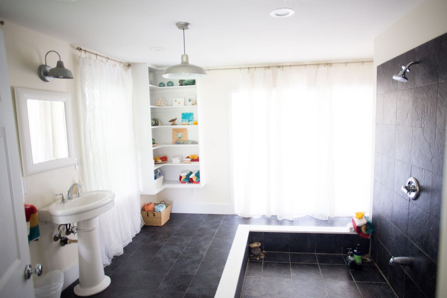 Spacious and airy bathroom with open shower