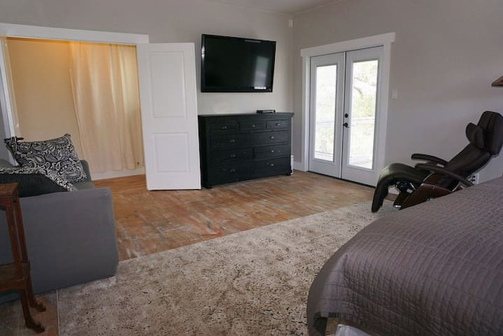 The upstairs Master has a large private TV and two entrances to a private balcony