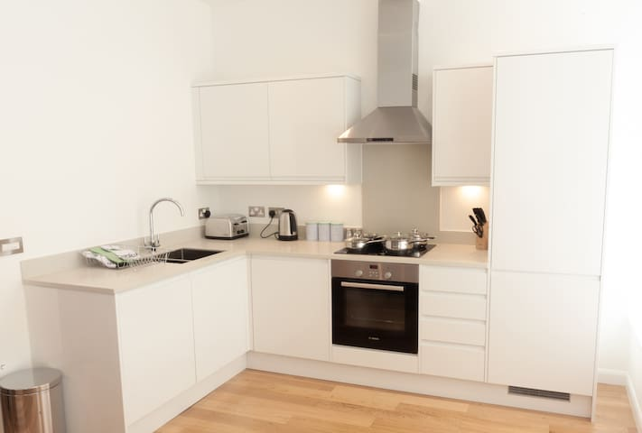 Your spacious private kitchen is fully equipped for your stay