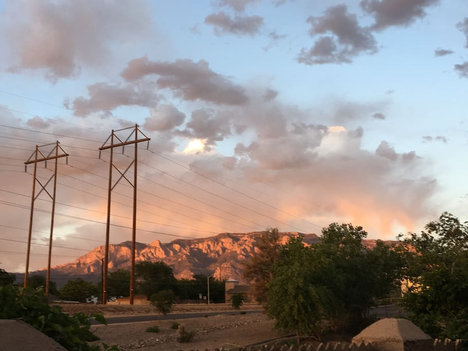 Beautiful sunset makes Sandia Mountains watermelon color.
