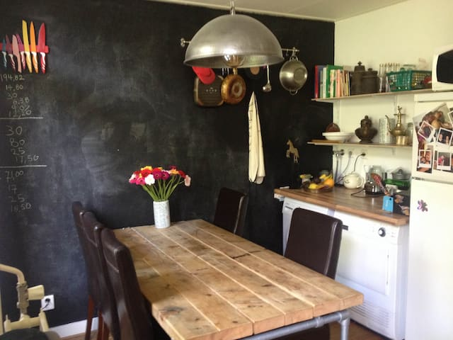 The big kitchen: great for dinners. Feel free to be creative on the chalk wall.