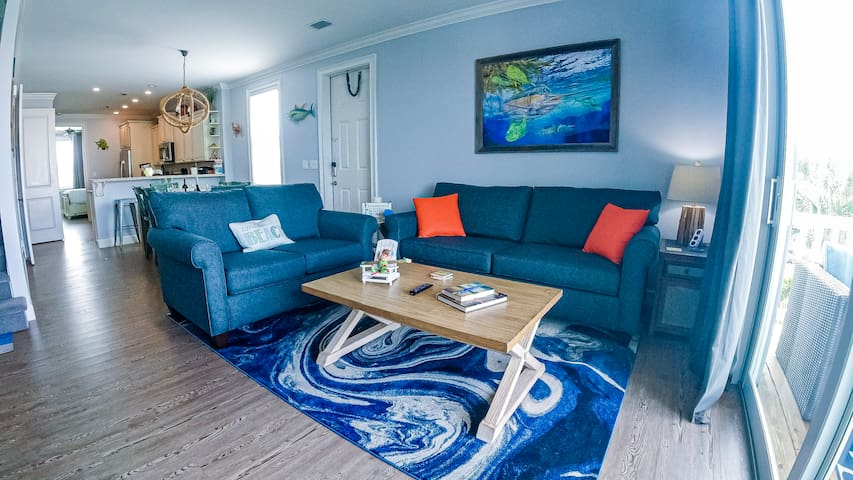 Living room with queen sleeper sofa and love seat. Big TV with Netflix and cable