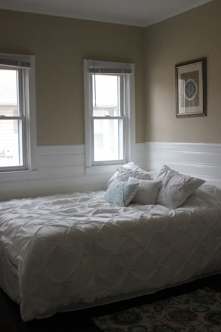 The second bedroom has a brand new queen bed with plenty of natural light.