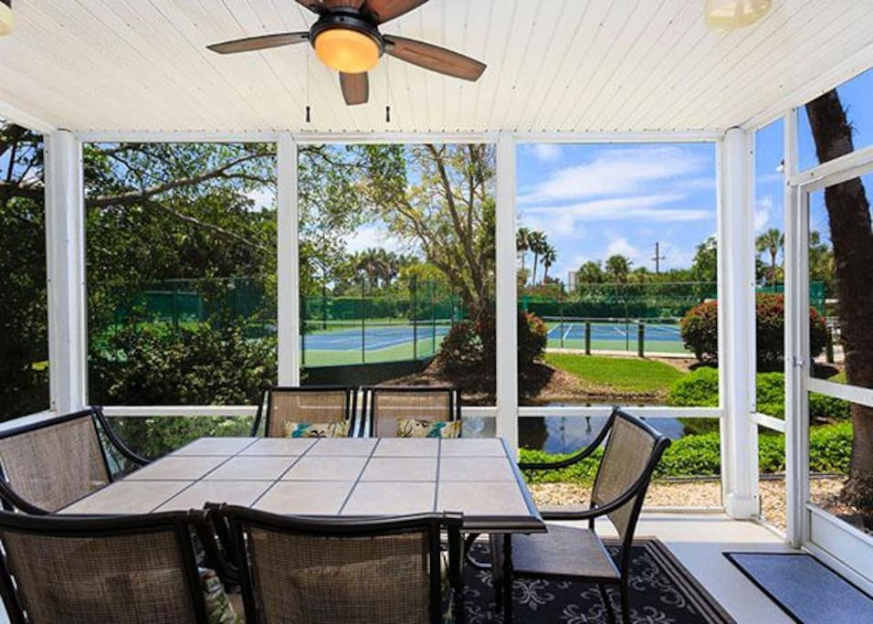 The big 11 x 16 foot lanai has breezes and great water views! - A creek runs along the edge of our back garden, bringin exotic bi