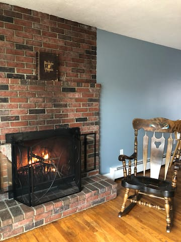 Cozy up by the wood burning fireplace.