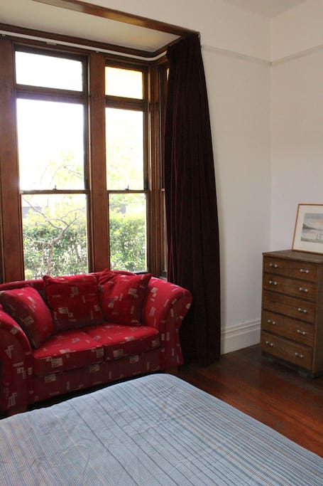 Your room also has a comfy two-seater couch and antique bedroom furniture.