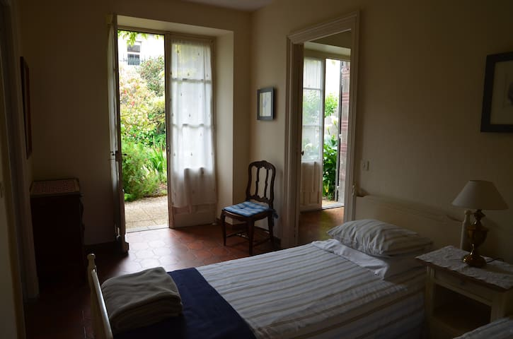 This is the twin-bedroom, looking towards the garden and the entrance to the main bedroom.