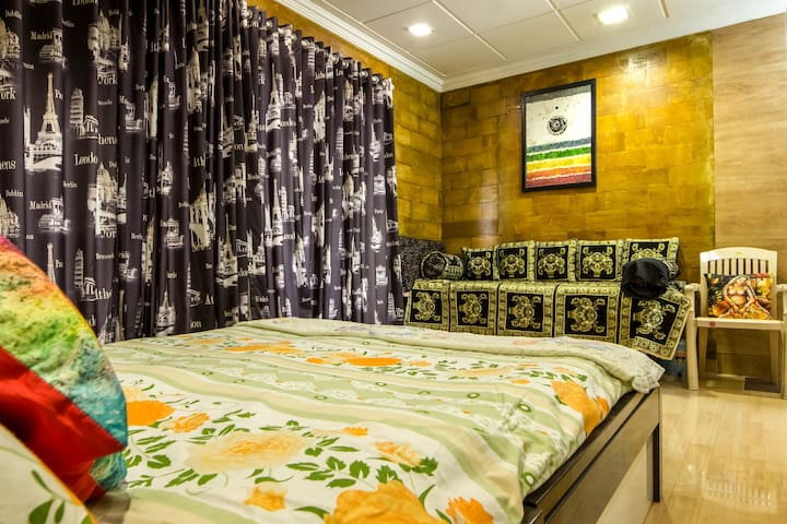 clean and comfortable bed with side Diwan bed.