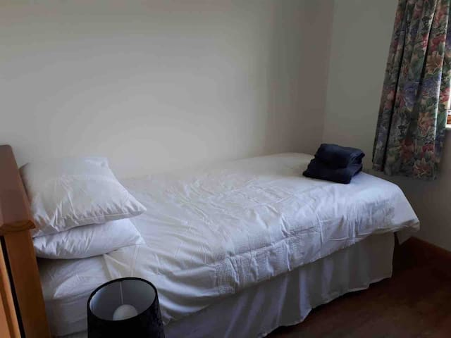 Bedroom 3 with Single Bed, Wardrobe and Toilet Wash hand basin adjacent.