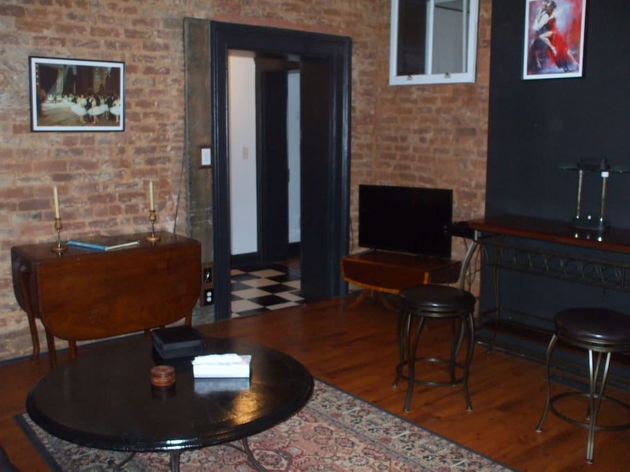Living Room with Exposed Brick & Original Casings