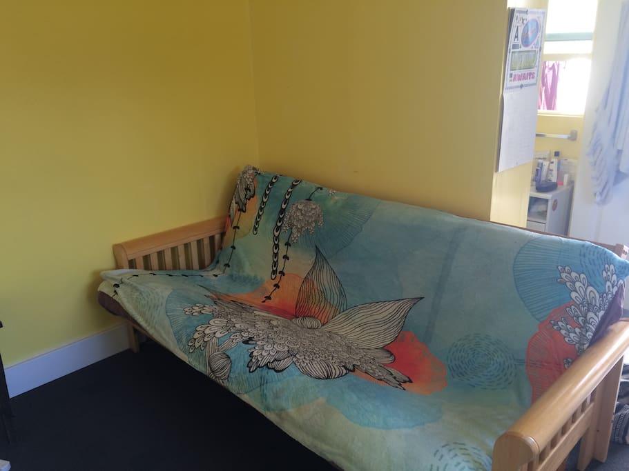 Futon sofa/bed.  Sleeps two comfortably.
