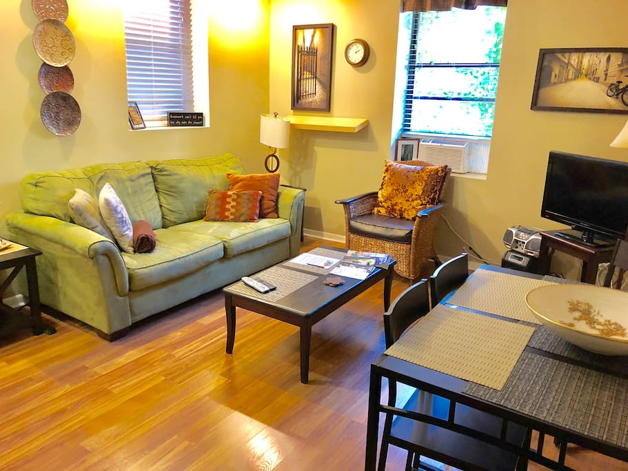living room area with dining table that seats 4