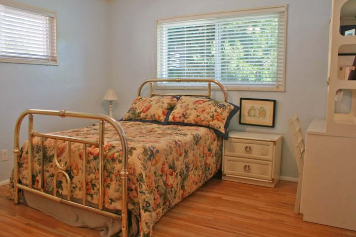 The second bedroom with a double-sized bed.