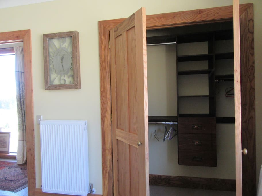 Good storage in each of the bedrooms + radiators for Winter warmth.