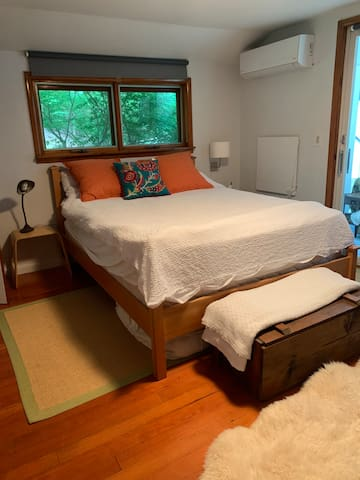 Bedroom with screened in porch outside