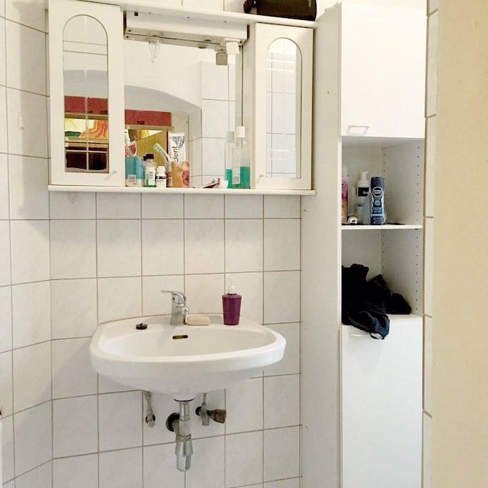 The bathroom with sink and a mirror (extra lights above)