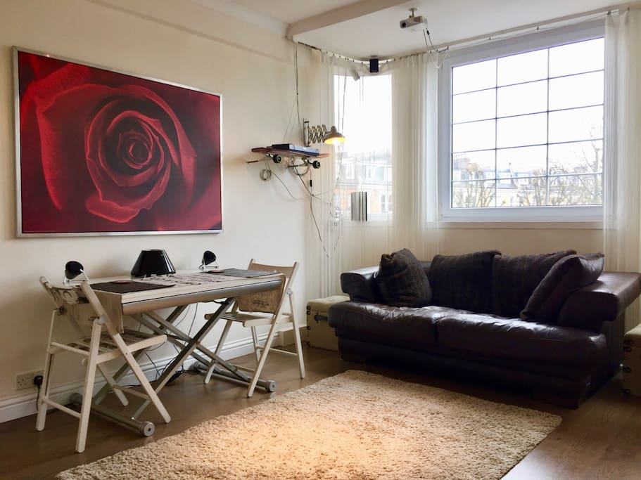 Bright and airy lounge includes ceiling-mounted movie projector and surround sound. Projector player included (plus DVD library), can also be hooked up to laptops