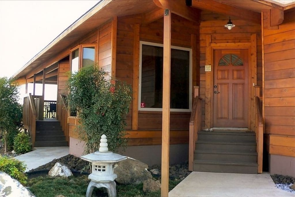 The front door is bordered with an attractive Japanese Rock Garden