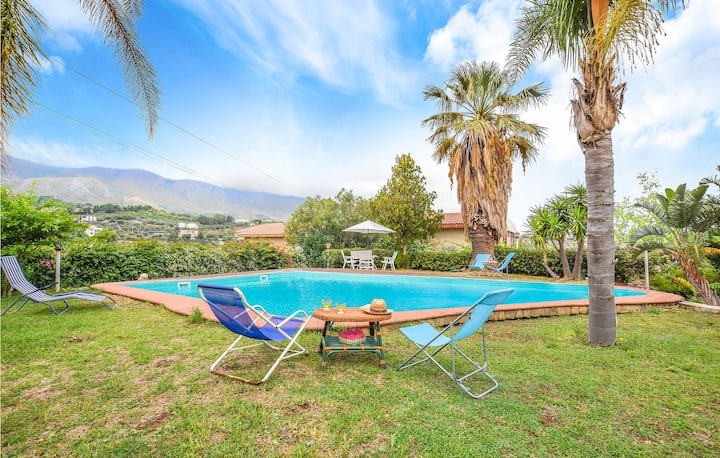 Nice home in Trabia with Outdoor swimming pool and 4 Bedrooms