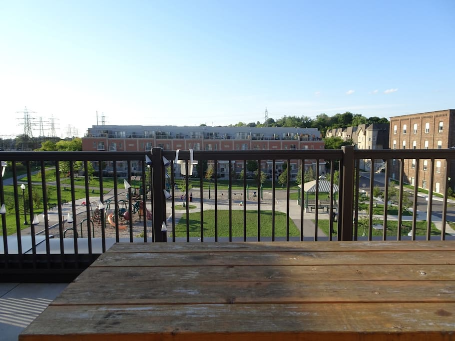 Rooftop patio view with large children's playground