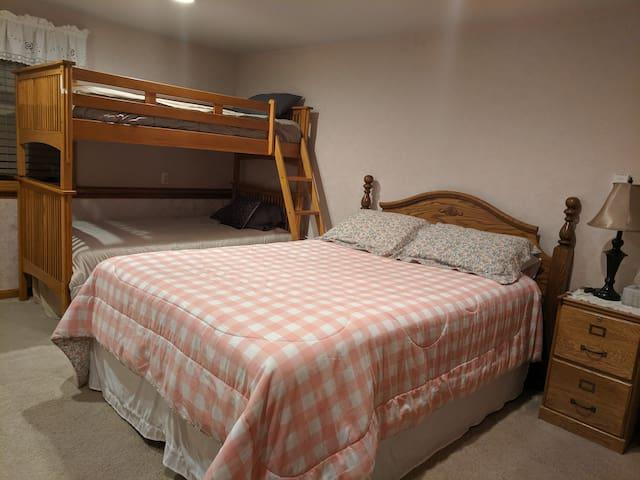Bedroom #2 - Queen bed, single bunks