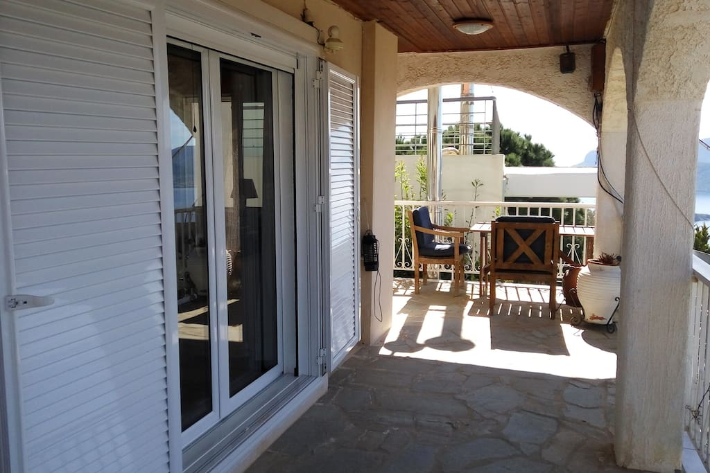 Large veranda at front of house, double-glazed windows allover