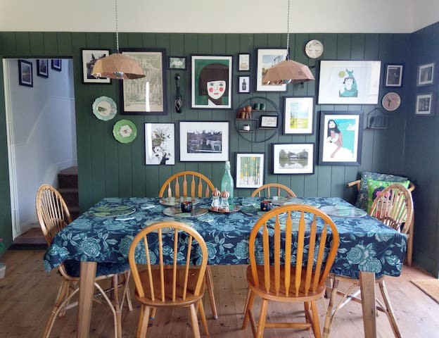 The large dining table comfortably seats six and overlooks the garden and mill pond.
