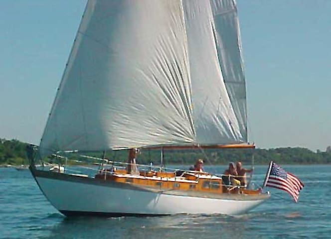 Classic yacht on Nantucket with bicycles